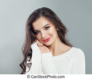 Young beautiful woman smiling. Portrait of pretty model girl with long hair and makeup