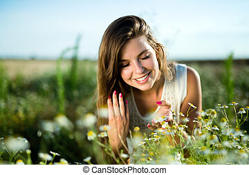 Young beautiful woman spending time in nature