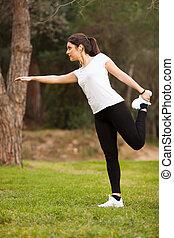 young beautiful woman stretching
