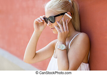 Young beautiful woman talking in the phone