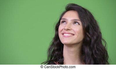 Young beautiful woman thinking