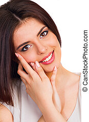 Young beautiful woman touching her face isolated