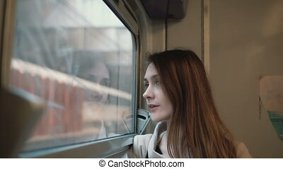 Young beautiful woman traveling by train. Attractive girl...
