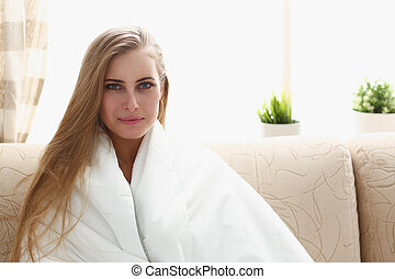 Young beautiful woman waking up in the morning