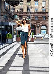 Young beautiful woman walking away