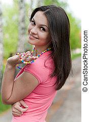 Young beautiful woman walking in park
