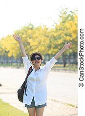 young beautiful woman wearing white shirts ,straw hat and...