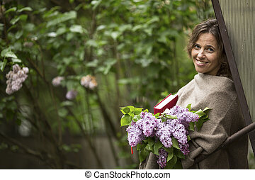 woman with a bouquet of lilacs