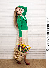 woman with a bouquet of tulips in a basket