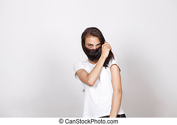 Young beautiful woman with a mustache from their hair