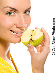 Young beautiful woman with apple slice isolated on white background