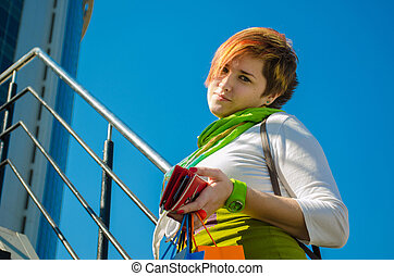 Young beautiful woman with bags after shopping