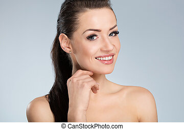 Young beautiful woman with black hair smiling