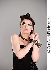 young beautiful woman with chain studio shot