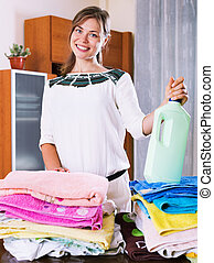 Young beautiful woman with colorful towels