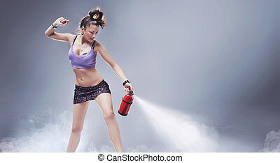 Young beautiful woman with fire extinguisher