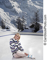 young beautiful woman with ice skates