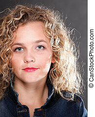 Young beautiful woman with long curly blond hair