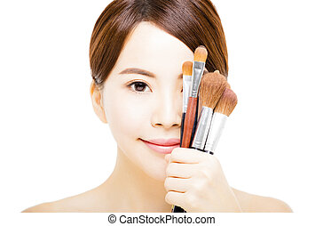 young beautiful woman with Makeup Brush