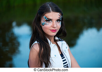 Young beautiful woman with sailor make-up