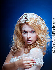 Young beautiful woman with snowy skin