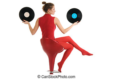 Young beautiful woman with vinyl records