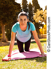 young beautiful woman work out on a park