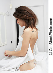 Young beautiful woman wrapped in a towel