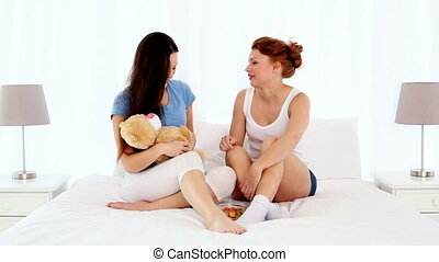 Young beautiful women sitting and chatting