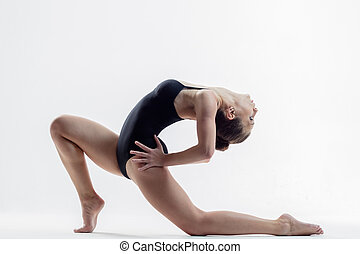 Young beautiful yoga posing in studio