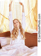 Young beautifulg blonde morning in the bed at morning