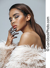 young beauty african american woman with fashion make up