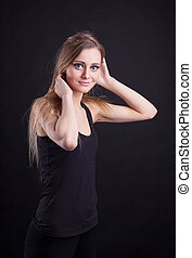 Young beauty blond girl in black tank top