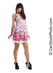young beauty brunette stand in summer dress