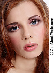 Close-up portrait of beautiful red-haired young girl