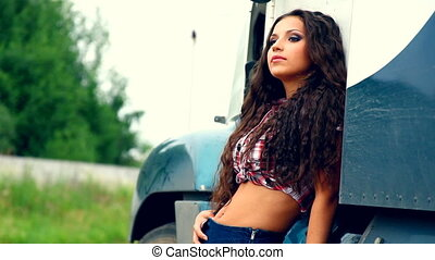 Young beauty girl and lorry truck in summer