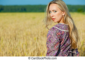 young beauty girl in the wheat field
