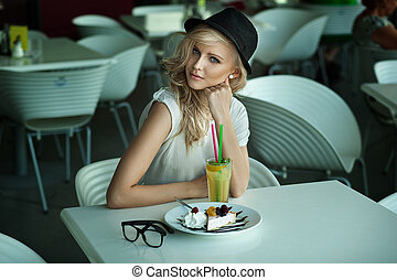 Young beauty in a restaurant