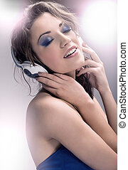 Young beauty listening to music
