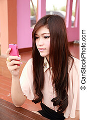 beauty smiling woman holding mobile phone