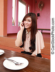 young beauty smiling woman talking on the cellphone