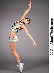 Young beauty woman dances in shorts