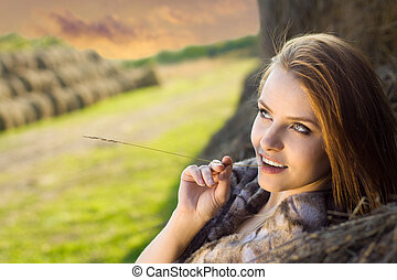 young beauty woman daydreaming at farm