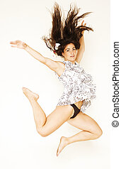 young beauty woman flying in jump with black hair on white background, lifestyle people concept