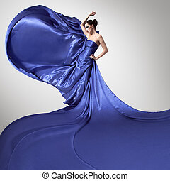 Young beauty woman in fluttering blue dress.