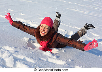 Young beauty woman lies on snow