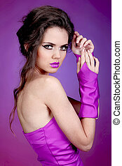 Young beauty woman portrait on bright purple background