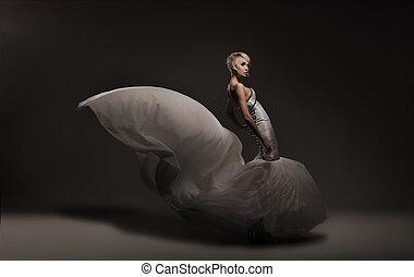 Young beauty woman wearing gorgeous dress