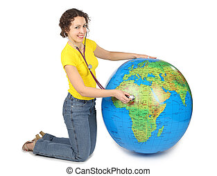 young beauty woman with stethoscope and big inflatable globe, smiling and looking at camera, isolated on white
