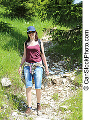 young beautyful woman in the mountains with blue hat